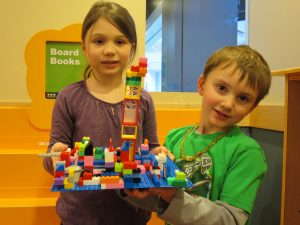 boy and girl with lego