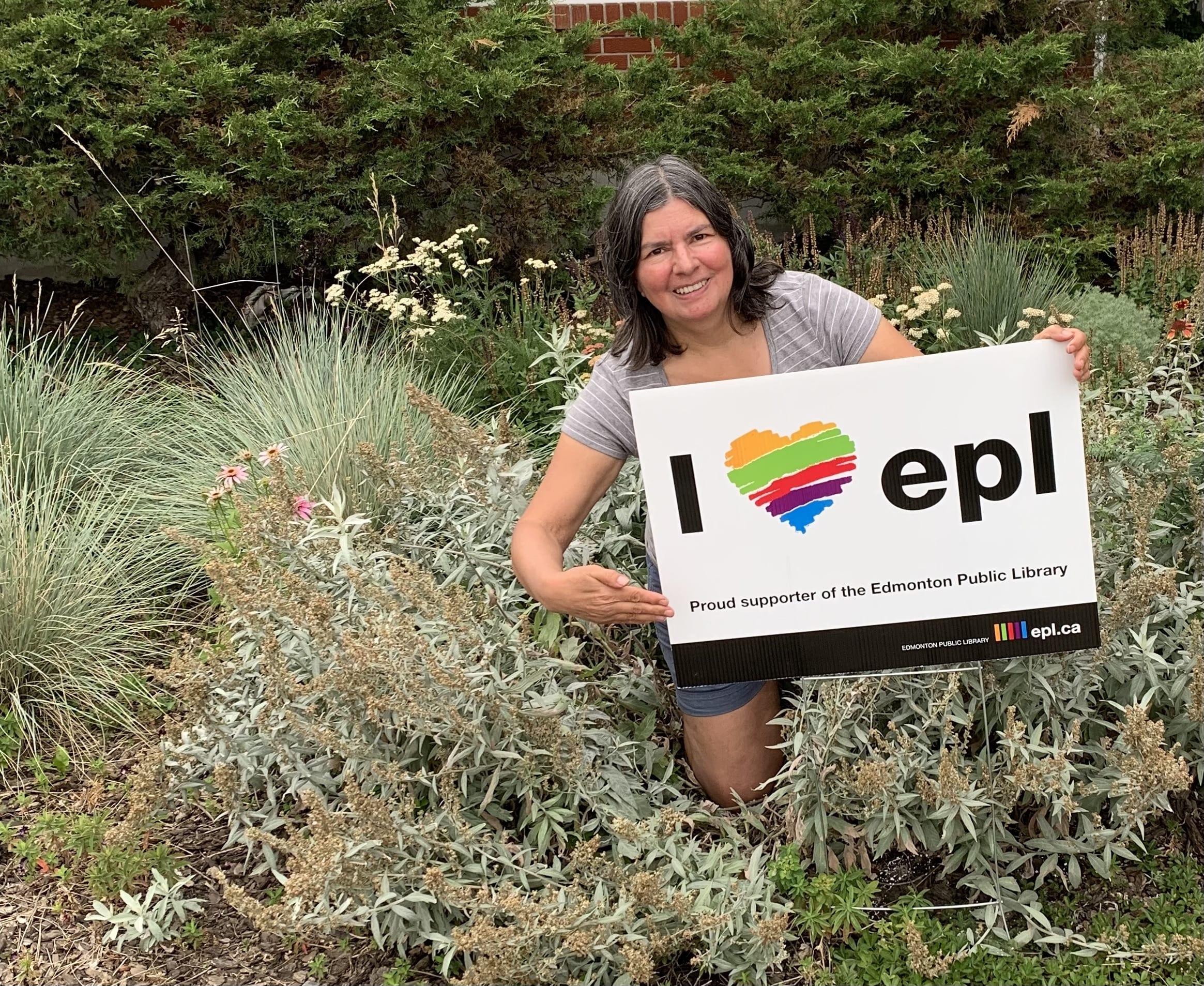 Sandra Marin holding EPL lawn sign