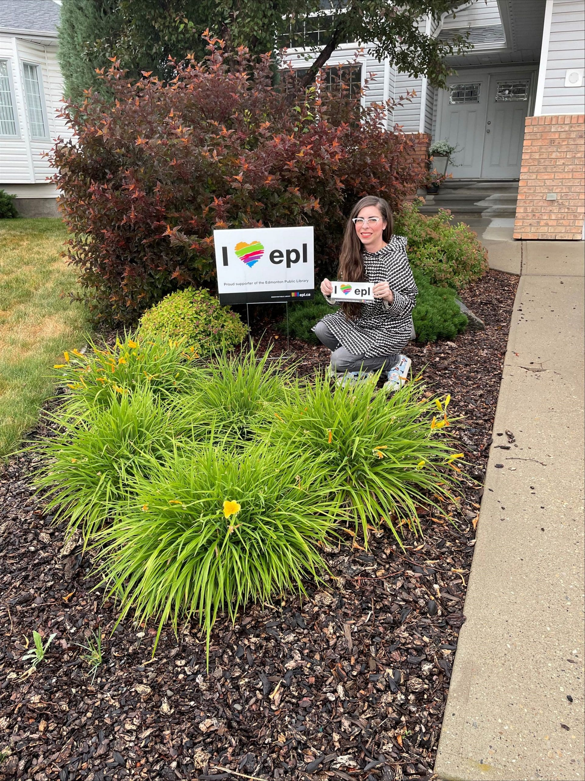Rosalie holding EPL lawn sign